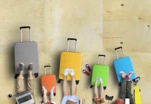 Family Is Going On A Trip, Five Colored Suitcases With Clothes And Accessories For Recreation.